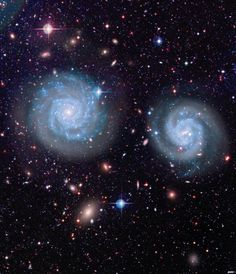 """distant-traveller: """" Opposite worlds The patterns of winding in the spiral arms of two large galaxies show they spin in opposite directions. A screen of stars belonging to our own galaxy, the Milky. Cosmos, Hubble Space Telescope, Space And Astronomy, Space Images, Space Photos, Across The Universe, Galaxy Space, Image Of The Day, To Infinity And Beyond"""