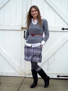 Belted sweater, plaid skirt, boot socks
