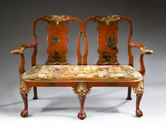 A 19th century, George Ist style, red chinoisoire and gilt double chair back setteewith an 18th century needlework seat, circa 1880 | Exhibitor: William Cook