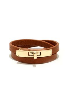 "The Locked In Tan Vegan Leather Wrap Bracelet will be the perfect companion to all of your cute bracelets and watches! Wrap this vegan leather bracelet around your wrist and secure with the gold turning lock closure. Bracelet measures 16.5"" long."