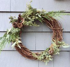 Winter wreath on grape vine.