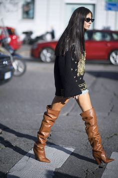 milan fashion week street style spring 2018 gilda ambrosio embellished black knit sweater denim shorts tan slouchy over the knee boots