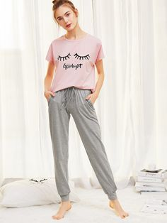 Shop Graphic Tee And Heathered Sweatpants PJ Set online. SheIn offers Graphic Tee And Heathered Sweatpants PJ Set & more to fit your fashionable needs. Cute Pajama Sets, Cute Pjs, Cute Pajamas, Pj Sets, Sporty Outfits, Cute Outfits, Fashion Outfits, A Line Skirt Outfits, Night Suit