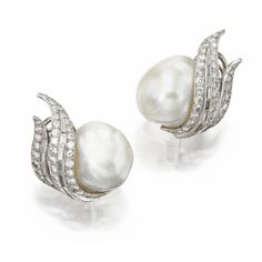 Pair of baroque cultured pearl and diamond earclips | lot | Sotheby's