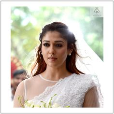 The ever-vibrant Nayanthara wearing a Seematti wedding saree in the film Bigil is simply fabulous. To more celebrity styling! To more gorgeousness! Christian Wedding Dress, Christian Bridal Saree, Christian Bride, Hairstyles For Gowns, Bride Hairstyles, White Wedding Gowns, White Bridal, Beautiful Indian Actress, Beautiful Bride
