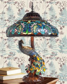 A lamp featuring a shade made up of several pieces of coloured glass soldered together is referred to as a Tiffany lamp. A Tiffany lamp is associated with beautiful lighting fixtures. Lamp, Beautiful Lamp, Tiffany Style Lamp, Tiffany Table Lamps, Peacock Decor, Beautiful Lighting, Room Lamp, Tiffany Lamps, Vintage Lamps