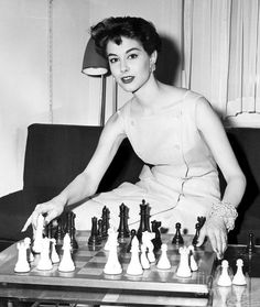 Nancy Berg Playing Chess Smiling For The Camera. 1955 Photograph by Anthony Calvacca: