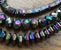 This 3-strand necklace is sure to stand out in a crowd. Each strand is made of a different shape of metallic hematite that beautifully catches the light and the eye. The iris-colored hematite provides a multidimensional rainbow effect of blues, purples, greens, and golds.
