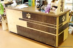 Patina metal work and wood reception desk for pet shop by Modern Craftsman