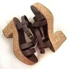 """Ash Leather Platform Sandal✨Host Pick✨ Beautifully crafted modern Euro sandals in dark brown leather with a cork platform. Leather upper/outer with a rubber sole. The style is called Wonder Bis and color is T Moro. Size is 38 Euro or 8 US. Length of inner sole: 9.5"""". Width: 3.5"""". Heel height: 3.5"""". Platform: 1"""". Does not come with box. Very light wear on the outer soles and a tiny nick at the front of left foot. EUC otherwise. Ash Shoes Platforms"""