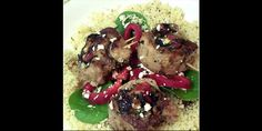 Spinach, red pepper & feta stuffed pork over herbed cous cous