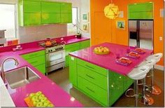 I love color....and I love pink and gree...even hot pink and lime green, but not with the orange wall and then a bright yellow light fixture....justcway too much color and way too busy!!! Paint the orange wall white and replace the light fixture with s simpler designed lantern in glossy white and you would have a bright cheerful modern kitchen!!!