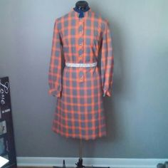Vtg orange & grey plaid label: Bleeker Street  color/pattern: Orange with gray plaid  sleeve: long  skirt: knee-length  enclosures: back zip and hook-n-eye at neck  addt?l: faux gold buttons on front             functional gold button at each cuff    bust: 20 in   sleeve: 22.5 in  waist: 18 in  hip: 20 in  length: 39 in    No belt  *sold as is*  Due to age you can expect some wear. Will note anything dramatic.  *measured flat and NOT doubled. Vintage Dresses Midi