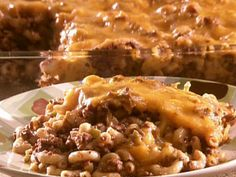 John would like... 1/4 to 1/2 lb. cheddar cheese 2 boxes Kraft macaroni and cheese dinner 1 1/2 to 2 lb. ground beef 1 lg. or 2 med. onions, chopped 1 sm. clove garlic or 1/2 tsp. garlic salt Cook and drain macaroni and prepare according to box directions and add 1/4 cup to 1/3 extra milk. In separate skillet, brown ground beef with onion and garlic. Put in a casserole dish and top with shredded cheese. COVER and bake for 20 minutes at 325 degrees, until cheese bubbles.