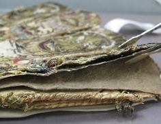 Detail showing second layer of pressed paper used to support embroidery. Image Cristina Balloffet Carr.  ca.1600,British. Leather,satin worked with silk and metal thread,seed pearls;satin,couching, and darning stitches;metal bobbin lace;paper. L.12 1/4 x W.6 1/4 inches (31.1 x 15.9 cm) Credit Line:Gift of Mrs. Edward S. Harkness, 1928 (28.220.7, .8)