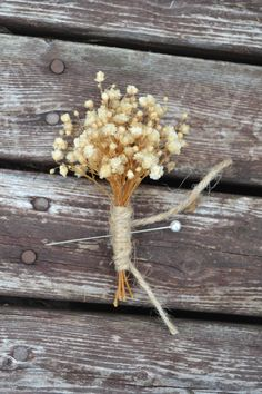 Super easy to make rustic babies breath boutonniere for the wedding. Hobby lobby sells dried babies breath!
