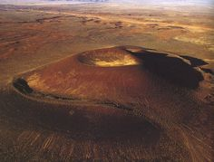 James Turrell Roden Crater. Still in the process. He's tunneling at 4 points into the crater's center to create a below-ground observatory.