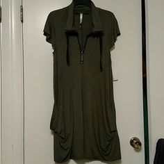 Kensie dress My loss your gain!!!  I'm unable to fit into this cute dress by Kensie. It will flatter any body shape. It has two pockets in front and zips into a turtle neck or just a v-neck cut. It's 95% viscose and 5% spandex.  Make an offer! Kensie Dresses