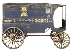 """Medicine delivery wagon. Horse-drawn delivery wagon adapted for use by Dr. Peter Mark, a manufacturer and purveyor of patent medicines active during the 1890s. All four sides of the wagon are decorated with faded stenciled or painted designs advertising Dr. Mark's patent medicines, including """"Sarsaparilla for the Blood"""" and """"Mark's Lung Balsam."""""""
