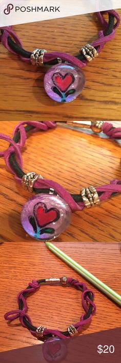 Hand painted glass bauble bracelet This purple and black leather wrap bracelet is one of a kind. The center piece is a Miz Meliz Original hand painted glass bauble. More colors and designs available. See more on Instagram, Twitter and Facebook @mizmelizla Jewelry Bracelets