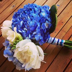 Bright  blue hydrangea with white peonies and freesia for a fresh nautical look!  Created by flowers by stem (www.flowersbystem.com).