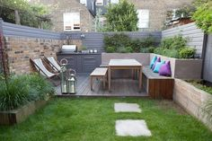 Low maintenance, child-friendly, Firemagic, outdoor kitchen garden design with vegetable garden and built-in seating in Gosberton Road, Balham, London