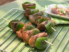 Spicy tomato sauce flavors pork tenderloins which are skewered along with green peppers and grilled.