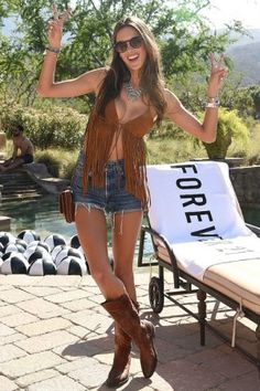 Alessandra Ambrosio wearing Golden Goose Boots, Forever 21 Genuine Suede Fringe Halter Top, BaubleBar X Ale by Alessandra Ambrosio Cape Town Bracelet Set, Redone Shorts, Wildfox Steff Sunglasses, BaubleBar X Ale by Alessandra Ambrosio Tuquoise Capri Amulet Necklace and Chanel Mini Messenger Bag