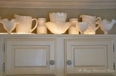 Rope light above cabinets.  Such an easy lighting trick. by Patricia Martin