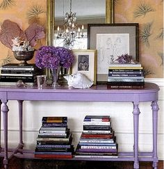 Not huge on the purple table but love all of the books and mix of stuff on it! Table Violet, Purple Table, Purple Desk, Purple Books, Purple Sofa, Home Design, Interior Design, Design Design, Design Ideas