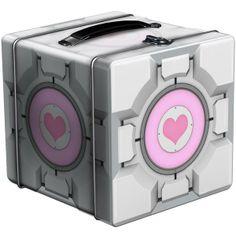 Portal 2: Tin Lunch Box: Companion Cube @ ForbiddenPlanet.com