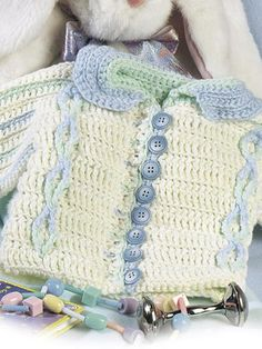 Button-Up Baby Cardigan - I kind of like how this looks (not that I am likely to make it) BUT - how many moms and how many 9 month old babies would appreciate all those buttons????