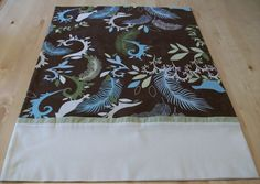 Brown pillowcase with green, blue, and cream colored leaves and French seams by JamesRiverCrafts on Etsy