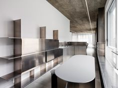 Frame Small Kitchenette, Long Shelf, Acoustic Panels, Cupboard Storage, Office Interiors, Corporate Interiors, Modern Buildings, Concrete Floors, White Walls
