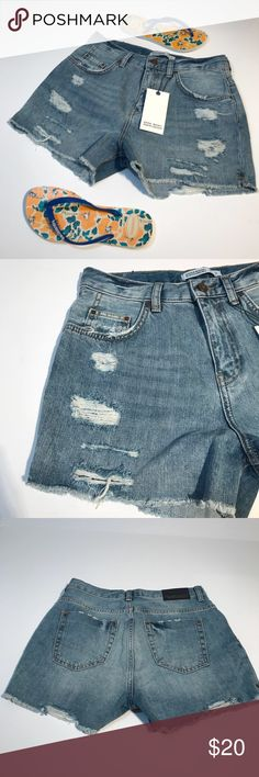 """ZARA BASiC Blue Denim Shorts Distressed Size 6 NWT These new denim shorts feature a classic 5 pocket design and have been distressed in all the right places. Inseam measures 2.5"""". Waist 14.5"""" laying flat. Rise 11.5"""". New with tags. Smoke free home. (CR) Zara Shorts Jean Shorts"""