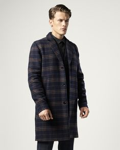 Jimmy wears trousers Marciano by Guess, plaid coat and shirt Samsøe &…