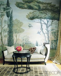 """The dining room of designer Rose Anne de Pampelonne's Beaux Arts mansion in Paris is adorned with murals inspired by landscapes in Renaissance paintings. Besides scenes of birds and trees, they include profiles of her children and portraits of family pets, adding a highly personal touch. "" Val: Think simpler with wallpaper trees"