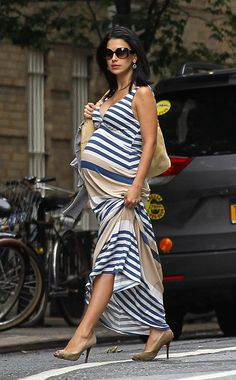 Hilaria Baldwin in a striped maxi paired with nude peep toe heels