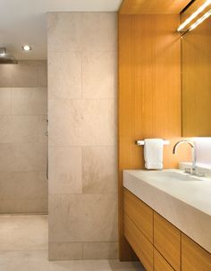 A honed limestone provides a monumental backdrop to a wooden double #vanity. #interior #design #bath #bathroom #design #home #design #masterbath   #InteriorDesign: Rohrer Studio | See more projects at: http://www.HandD.com/DianneRohrer