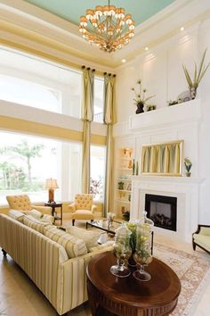 living room. sofas and chairs. iights lamps chandeliers. Cabinets and tables. carpets and fabrics. drapes and ceiling design. art and accessories. color decor modern interior design