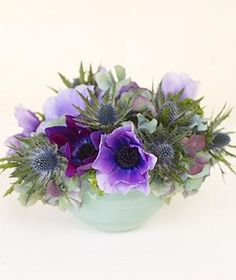 The graphic anemone, eryngium, and hydrangea make for a high-impact low centerpiece.