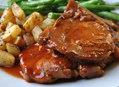 Slow Cooker BBQ Pork Chops ~~~ Making pork in the slow cooker makes it fall-off-the-bone. This recipe for Slow Cooker BBQ Pork Chops is no exception! You will also enjoy the unique flavors in the special sauce – a twist on your typical BBQ sauce. Crock Pot Food, Crockpot Dishes, Pork Dishes, Crock Pot Slow Cooker, Slow Cooker Recipes, Crockpot Recipes, Cooking Recipes, Cooking Tips, Bbq Pork
