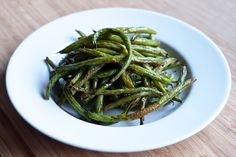 Roasted Green Beans 1 pound green beans, stem ends removed 2 tablespoons melted coconut oil, ghee, or fat of choice 1 teaspoon Red Boat Fish Sauce Freshly ground black pepper Juice from half a lime or lemon