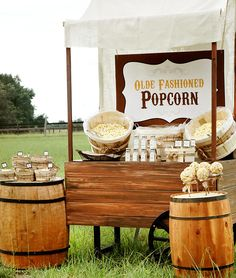 Instead of the popular candy bar why not try something different with this Rustic Popcorn Bar!  Set out peanut or candy mixers, various shakers of toppings and maybe a few popcorn balls!