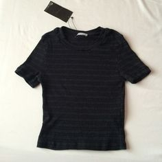 NWT Zara black stripped fitted crop top NWT Zara black and grey ribbed crop top that has a slim fitting. Size medium. Never worn and in great condition. Ask for try on pics or bundles. Zara Tops Crop Tops