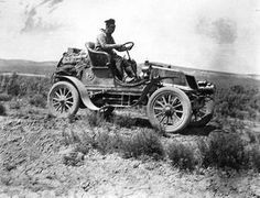 Nelson Jackson and his dog Bud were the first people to cross the US in an automobile in 1903. They drove a Winton automobile and the trip took 63 days. There were no cross-country roads or highways and many times he had to follow rail-road tracks. Oldsmobile and Packard tried to race him but their cars broke down from from the finish line in NYC.
