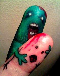 biting tattoo fingers