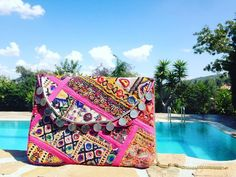 This beauty is handcrafted by our artisans in India using vintage tribal embroidery. Shop our best-selling pink clutch online on be-snazzy.com #bohochic Embroidery Shop, Pink Clutch, Summer Accessories, Baggage, Hand Stitching, Boho Chic, Messenger Bag, Artisan, Satchel