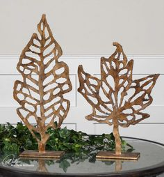 Uttermost 19583 Hazuki Sculpture - Set of 2 - Metal construction Distressed gold leaf finish Dark espresso undertones Light tan glaze Small: x x inches Large: x inches .