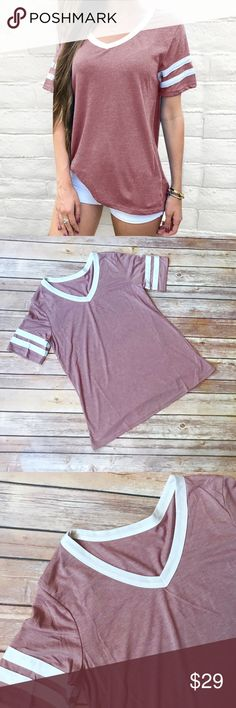 """Hayden Sporty V Neck Shirt Super cute sporty style v neck shirt. The color is kind of a very very light faded purple red color. It has white on the neckline and white striped on the sleeves. Goes perfect with leggings or as a workout shirt. Length 25"""". 100% Cotton. Inventory number 47. Tops Tees - Short Sleeve"""